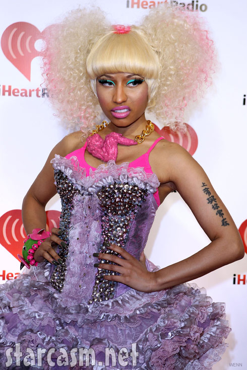 Nicki Minaj wears a pink chicken wing to the I Heart Radio music festival