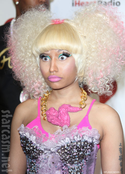 Nicki Minaj wears a hot pink fried chicken wing necklace to I Heart Radio music festival