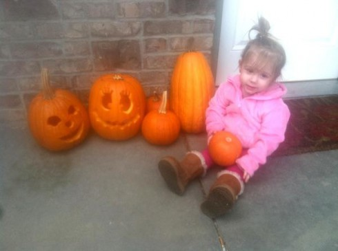 Aubree Skye of Teen Mom 2 chills with some jack-o-lanterns just before Halloween 2011