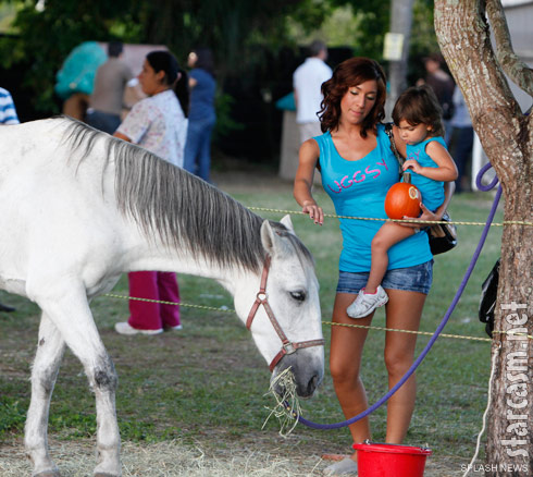 Teen Mom Farrah Abraham takes her daughter Sophia Abraham to the pumpkin patch where they pet a horse