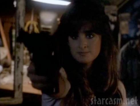 Kyle Richards shoots a gun in the 1989 film Curfew