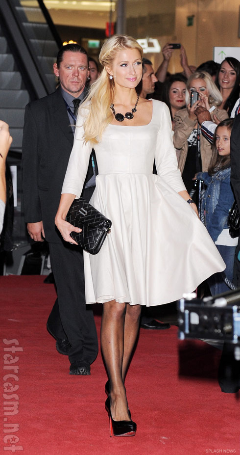 Paris Hilton looking elegant in a white dress in Poland