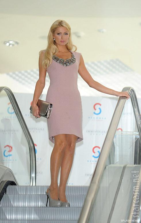 Paris Hilton on an escalator at the Silesia City Center mall in Katowice, Poland