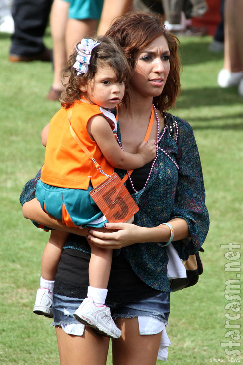 Farrah Abraham at a Miami Dolphins game with daughter Sophia