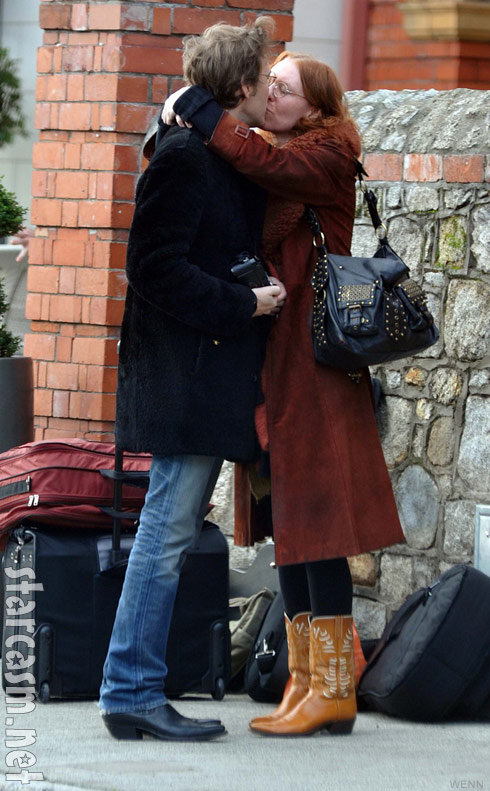 Gillian Welch kisses David Rawlings outside the Dylan Hotel in Dublin Ireland