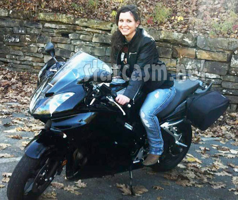 Corey Simms new reported girlfriend Elizabeth Norman on a motorcycle