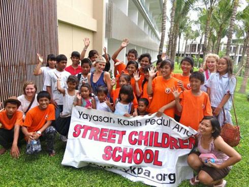 Paris Hilton visits an orphangage in Bali