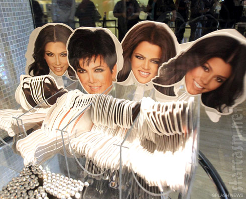 Fans with photos of the Kardashian's faces on them at Kardashian Khaos