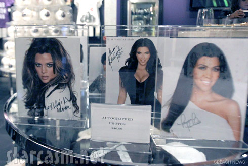 Khloe Kourtney and Kim Kardashian signe photos for sale at Kardashian Khaos