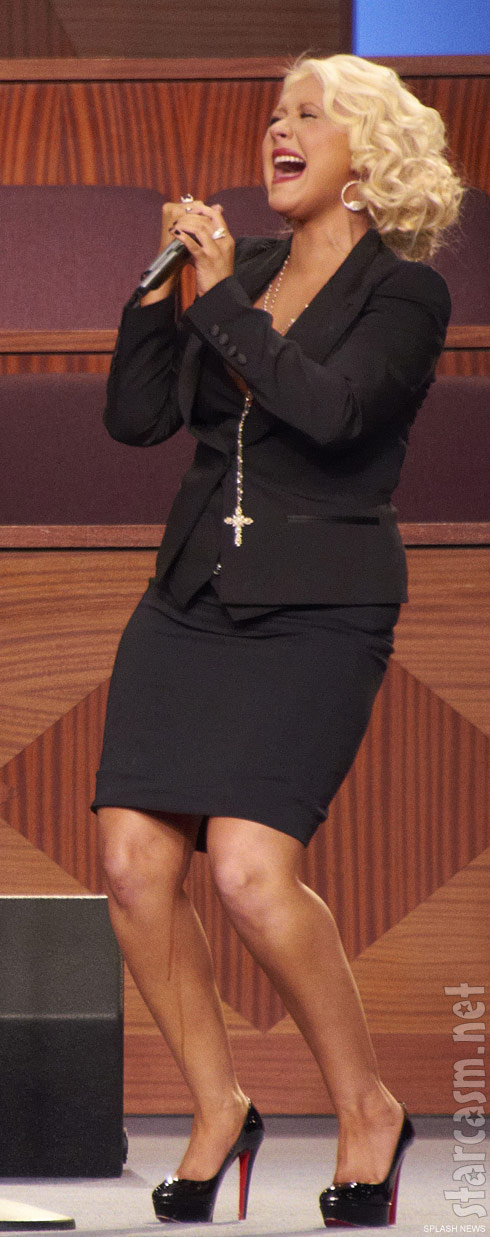 Christina Aguilera with a mystery fluid flowing down her leg at Etta James' funeral