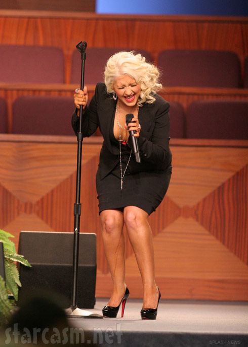 Christina Aguilera with a mystery liquid running down her leg at Etta James' funeral
