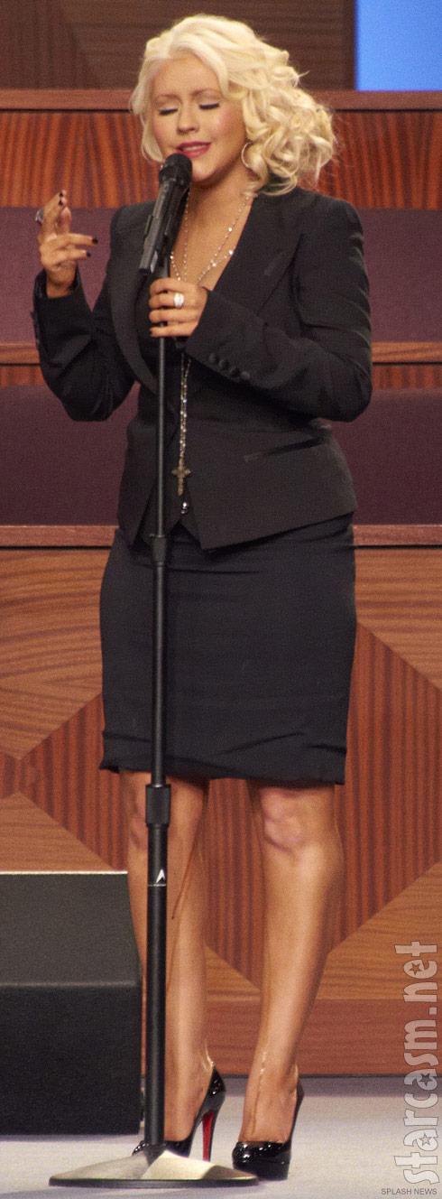 Christina Aguilera mystery liquid on her legs at Etta James funeral