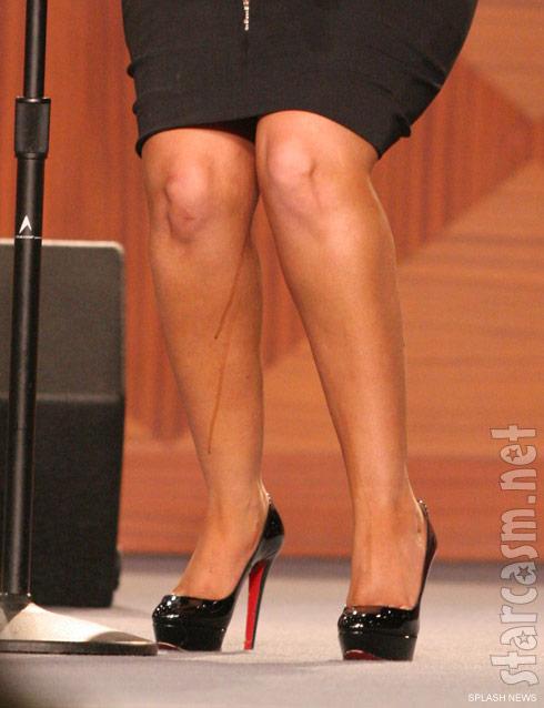 Mystery liquid on Christina Aguilera's legs at Etta James' funeral service