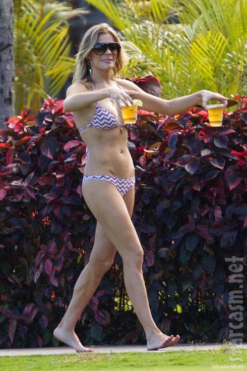 LeAnn Rimestoting beer in a bikini