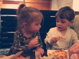 Aubree and Jace eating French fries together in New York City