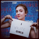 Lena Dunhamholding a sign at the HBO Girls premiere in New York City April 4 2012