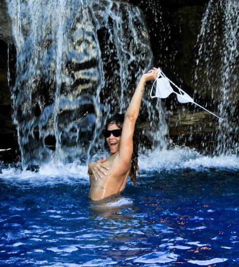 Rihanna topless under a waterfall