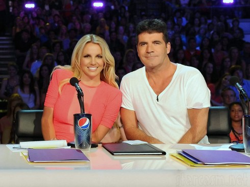 Britney Spears at the X Factor judges' table with Simon Cowell