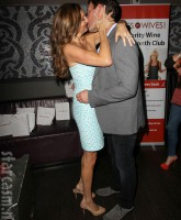 Heather McDonald and Jeff Lewis kiss at the Wines By Wives launch event May 8 2012