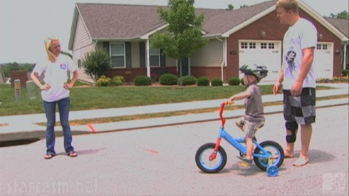 Kyle King and Maci Bookout teaching Bentley how to ride a bike