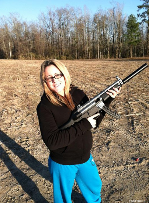 Jenelle Evans firing a machine gun with Gary Head