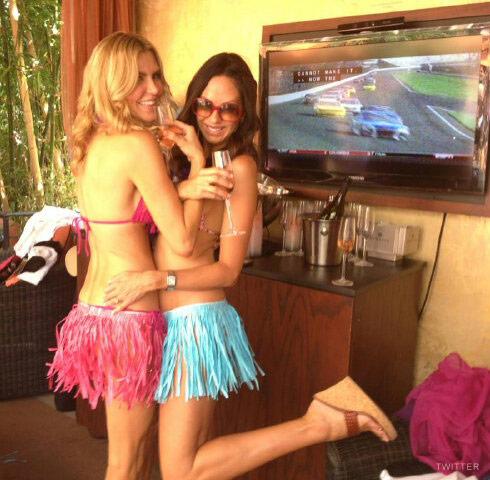 Brandi Glanville in a bikini and hot pink grass skirt in Las Vegas