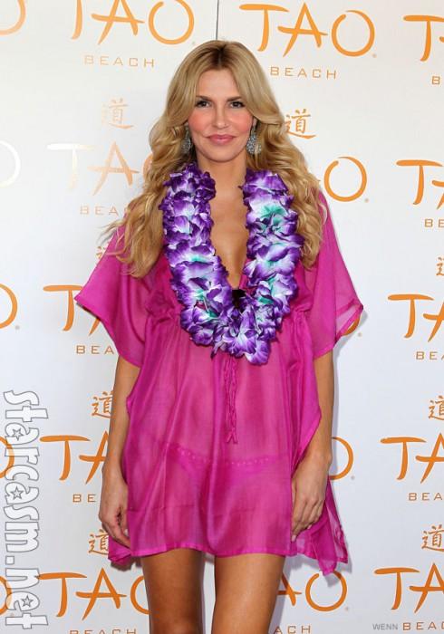 Brandi Glanville in a hot pink cafta and bikini