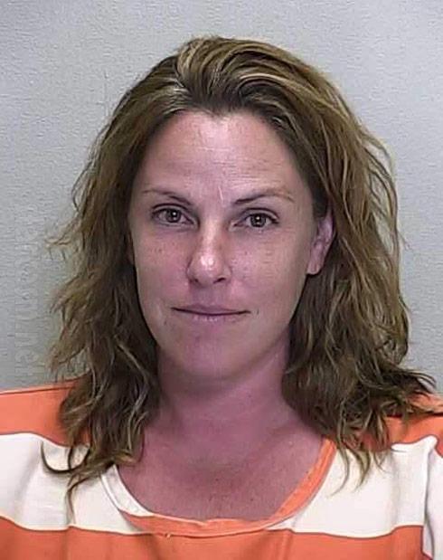Mugshot Mandy Woodard driving truck topless