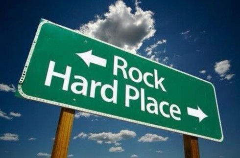 Between a rock and a hard place street sign