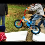 Maci Bookout's son Bentley jumps a ramp n a bicycle during his 4th birthday party