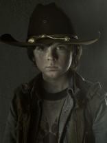 Chandler Riggsas Carl Grimes on The Walking Dead Season 3 photo