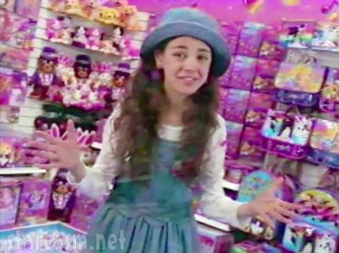 Young Mila Kunis acting in a TV commercial for Lisa Frank stickers