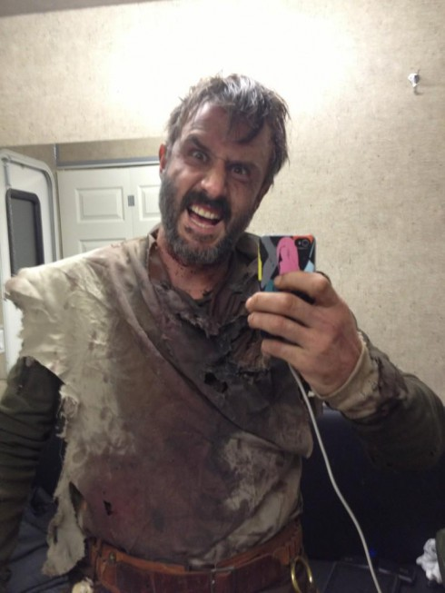 David Arquette snaps a photo on his iPhone on the set of Orion
