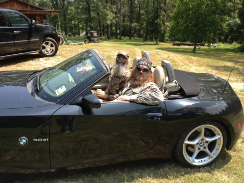 Willie RObertson and Si Robertson take a ride in a BMW convertible