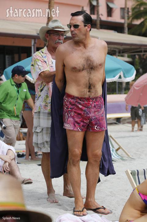 Jon Hamm on the beach chest