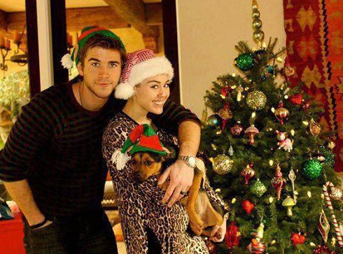 Liam Hemsworth and Miley Cyrus on Christmas with wedding bands