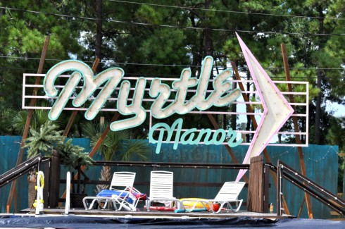 TLC Welcome to Myrtle Manor logo sign