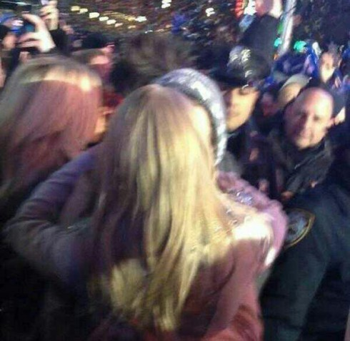 Taylor Swift and her One Direction boyfriend Harry Styles share a New Year's Eve kiss in New York City
