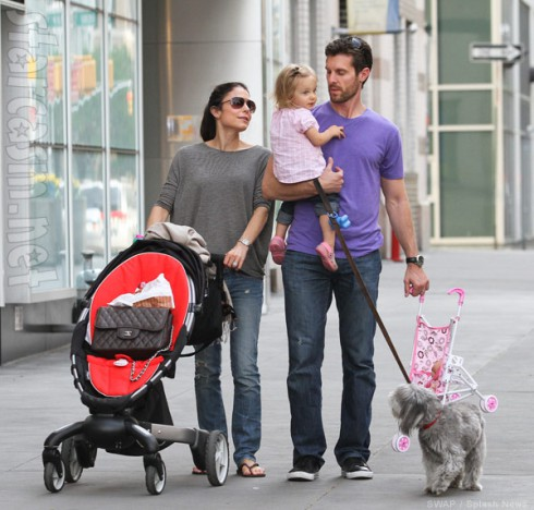 Bethenny Frankel and Jason Hoppy go for a walk with daughter Bryn and their dog