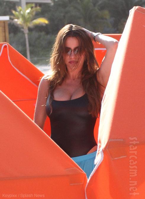 Sofia vergara sunning on Miami Beach
