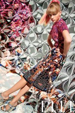 Taylor Swift in dark floral print outfit in Elle Magazine