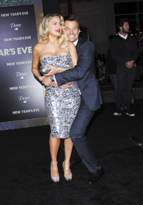 Josh Duhamel and Fergie aka Stacy Ferguson attend the Los Angeles premiere of 'New Year's Eve' at Grauman's Chinese Theatre in Hollywood, California.