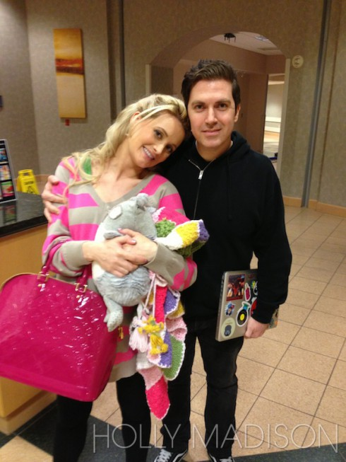 Holly Madison after giving birth to daughter Rainbow Aurora Rotella