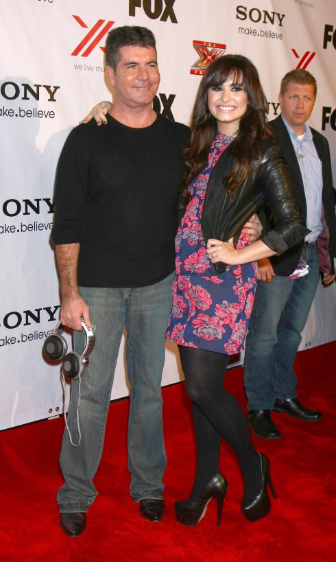 Simon Cowell and Demi Lovato attend The X Factor 2012 Final Four Party at Rodeo Drive in Beverly Hills, California, United States.