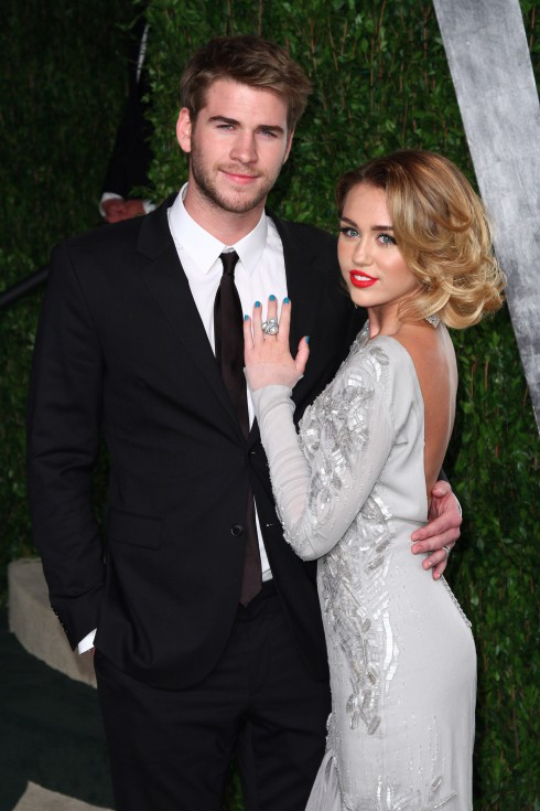 Miley Cyrus and Liam Hemsworth at the 2012 Vanity Fair Oscar Party at Sunset Tower Hotel in West Hollywood. USA.