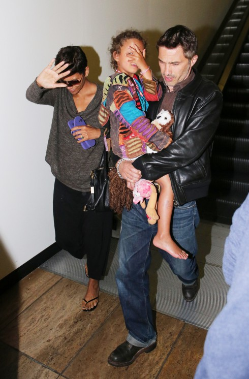 Halle Berry arrives at LAX airport with her fiance Olivier Martinez and her daughter Nahla Aubry in Los Angeles, California, United States.