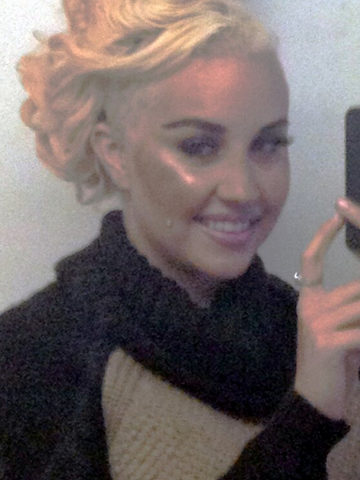 Amanda Bynes shaves the side of her head