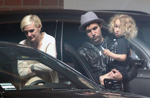 Ashlee Simpson chats with Meagan Camper in the parking lot at Jessica Simpson's Baby Shower as Fall Out Boy bassist Pete Wentz waits patiently holding his son Bronx in Los Angeles, California.