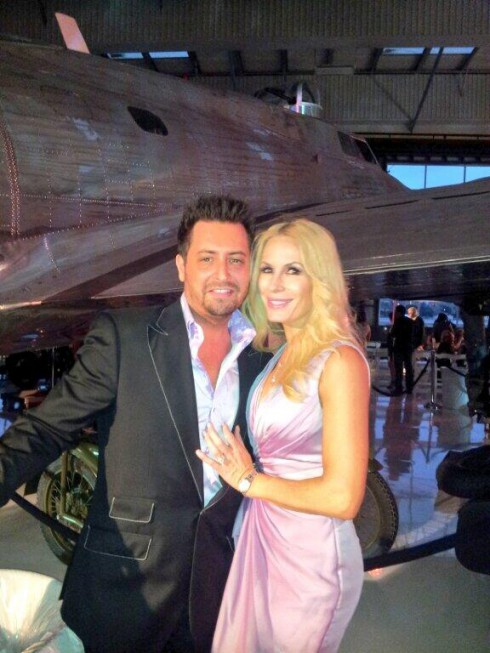 Micah and Peggy Tanous at a fashion show at the Lyon Air Museum