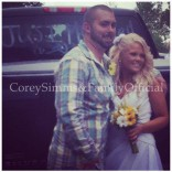 Corey Simms wedding photo wearing flannel and jeans